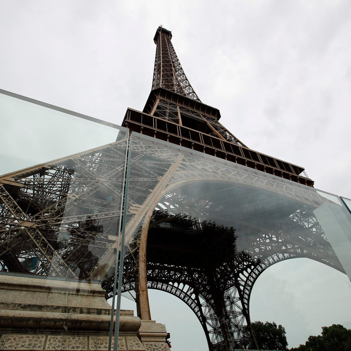 View of a new security bulletproof glass barrier under construction around the Eiffel Tower in Paris, France, Thursday, June 14, 2018.