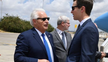White House Senior Advisor Jared Kushner speaks with U.S. Ambassador to Israel David Friedman upon Kushner's arrival at the Ben Gurion International Airport, near Lod, Israel May 13, 2018. Courtesy David Azagury/U.S. Embassy Tel Aviv/Handout via REUTERS    ATTENTION EDITORS - THIS IMAGE WAS PROVIDED BY A THIRD PARTY.