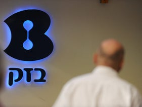 The logo of Bezeq Israeli Telecommunication Corp. is seen at the company's headquarters in Tel Aviv, Israel, on Wednesday, Dec. 29, 2010