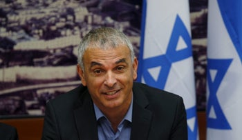 Moshe Kahlon, Israel's new Finance Minister, attends a meeting at the Finance Ministry in Jerusalem, May 18, 2015