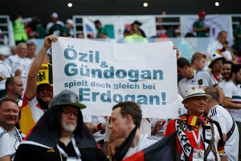 Germany fans display a banner referencing Germany's Mesut Ozil and Ilkay Gundogan and Turkish President Tayyip Erdogan inside the stadium before the match, Moscow, Russia, June 17, 2018