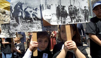 Armenian children holding signs as they take part in a memorial march in Jerusalem's Old City in 2005 to commemorate the Armenian genocide. (Olivier Fitoussi / BauBau)