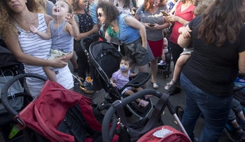 Parents demonstrate to demand legislation for tighter supervision at day care centers after the death of a toddler in Petah Tikvah.
