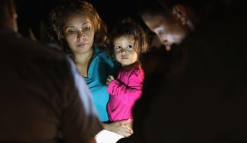 MCALLEN, TX - JUNE 12: Central American asylum seekers, including a Honduran girl, 2, and her mother, are taken into custody near the U.S.-Mexico border on June 12, 2018 in McAllen, Texas. The group of women and children had rafted across the Rio Grande from Mexico and were detained by U.S. Border Patrol agents before being sent to a processing center for possible separation. Customs and Border Protection (CBP) is executing the Trump administration's zero tolerance policy towards undocumented immigrants. U.S. Attorney General Jeff Sessions also said that domestic and gang violence in immigrants' country of origin would no longer qualify them for political asylum status.   John Moore/Getty Images/AFP