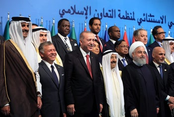 Emir of Qatar Sheikh Tamim bin Hamad al-Thani (far left) and Iran's President Hassan Rohani (second right) in a meeting of the OIC in Istanbul, Turkey May 18, 2018.