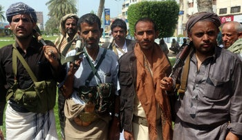 Houthi rebels are seen during a gathering to mobilize more fighters to the battlefront to fight pro-government forces, in the Red Sea port city of Hodeidah on June 18, 2018.