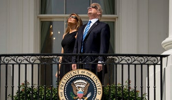 President Donald Trump and first lady Melania Trump wear protective glasses as they view the solar eclipse at the White House, Monday, Aug. 21, 2017.