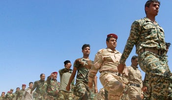 Popular Mobilisation Forces (PMF) march during a military parade in Daquq, nearby Kirkuk, Iraq August 5, 2017