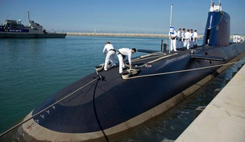 """In this Jan. 12, 2016 file photo, Israeli sailors stand on a German-built  """"Rahav"""" submarine on its arrival in to the military port in Haifa, Israel."""