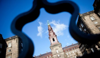 Denmark's parliament building, the Christiansborg Palace, is seen through railings in Copenhagen, Denmark, on Tuesday, March 13, 2012.