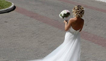 FILE PHOTO: A bride waits for her groom in the outskirts of Podolsk near Moscow, Russia, Saturday, June 16, 2018.