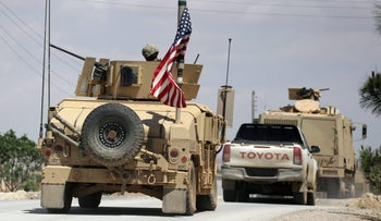 The U.S. flag flutters on a military vehicle in the Manbej countryside, Syria, May 12, 2018.