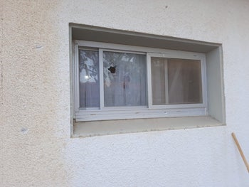 A window that was damaged in the Eshkol Regional Council on June 20, 2018