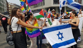 Ilana Edner, marching behind the Israeli flag, with participants of the Jewish contingent of the gay pride parade in Malmo, Sweden, June 10, 2018