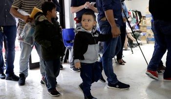 Young immigrants arrive with their parents at the Catholic Charities RGV after they were processed and released by U.S. Customs and Border Protection, McAllen, Texas, June 19, 2018.