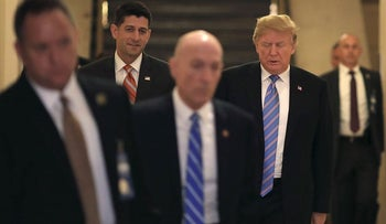 U.S. President Donald Trump, rear right, and U.S. House Speaker Paul Ryan, a Republican from Wisconsin, rear left, walk to a House Republican conference meeting on immigration legislation at the U.S. Capitol in Washington, D.C., U.S., on Tuesday, June 19, 2018