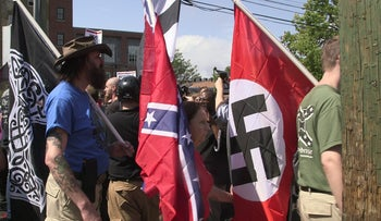 File photo: Demonstrators carry confederate and Nazi flags during the Unite the Right free speech rally at Emancipation Park in Charlottesville, Virginia, USA on August 12, 2017.