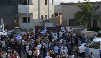 A demonstration in Afula, northern Israel, against a home being sold to an Arab family, June 13, 2018.
