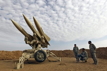 Iranian military prepare missiles to be launched. Iran claims its air defenses can challenge potential Israeli air strikes. Nov. 13, 2012