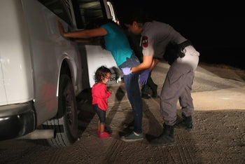The viral image of a two-year-old Honduran asylum seeker crying as her mother is searched and detained near the U.S.-Mexico border, McAllen, Texas, June 12, 2018.