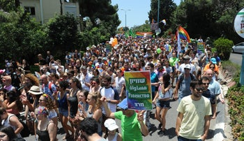 Thousands of people marching in the city of Haifa during the Gay Pride Parade on June 22, 2018.
