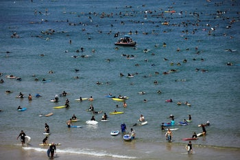 Hundreds of surfers protesting against a gas rig project in Herzliya.
