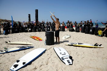 Israeli protesters preparing to go surfing in a demonstration for environmental protection in Herzliya.