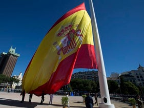 A giant Spanish flag is raised during a ceremony celebrating the 4th anniversary of the proclamation of Spain's King Felipe VI in Madrid, Spain, June 19, 2018.