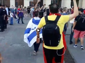 Soccer fan wearing Israeli flag harassed in Moscow during the World Cup, 2018.
