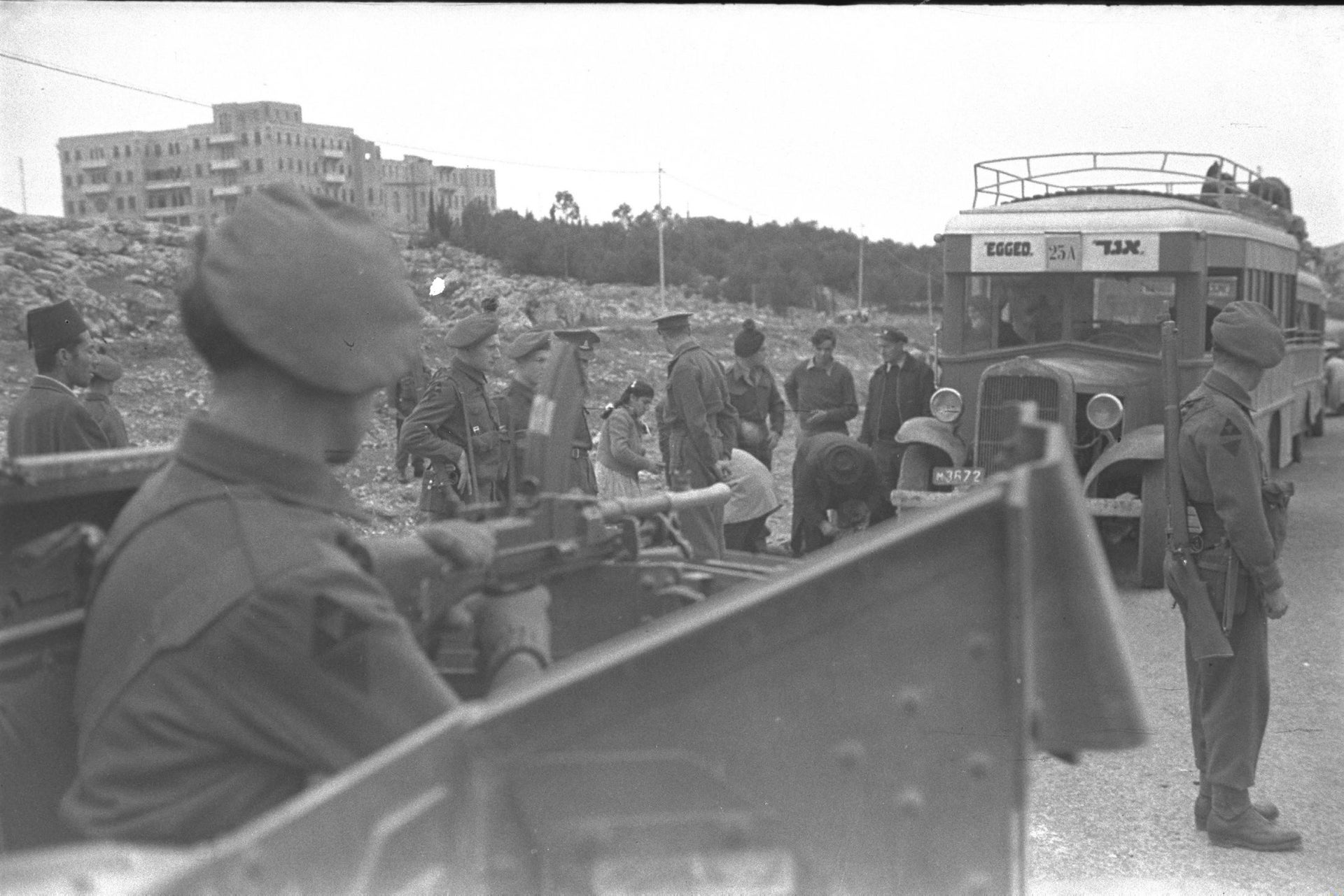 """British soldiers searching """"Egged"""" bus passengers on their way to Jerusalem."""