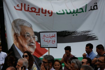 Protesters demanding the lifting of sanctions on Gaza Strip, in the West Bank city of Ramallah, June 12, 2018.
