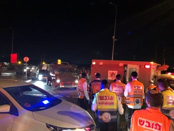 Emergency medical teams at the scene of a suspected car-ramming attack in the Palestinian village of Husan, June 23, 2018.