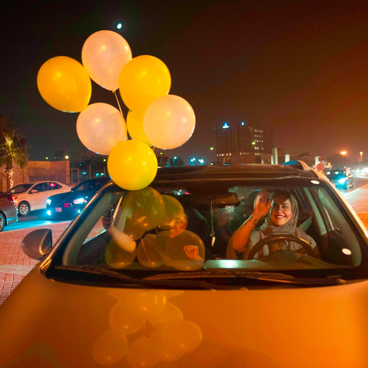 A Saudi woman and her friends celebrate her first time driving on a main street of Khobar City on her way to Kingdom of Bahrain on June 24, 2018.