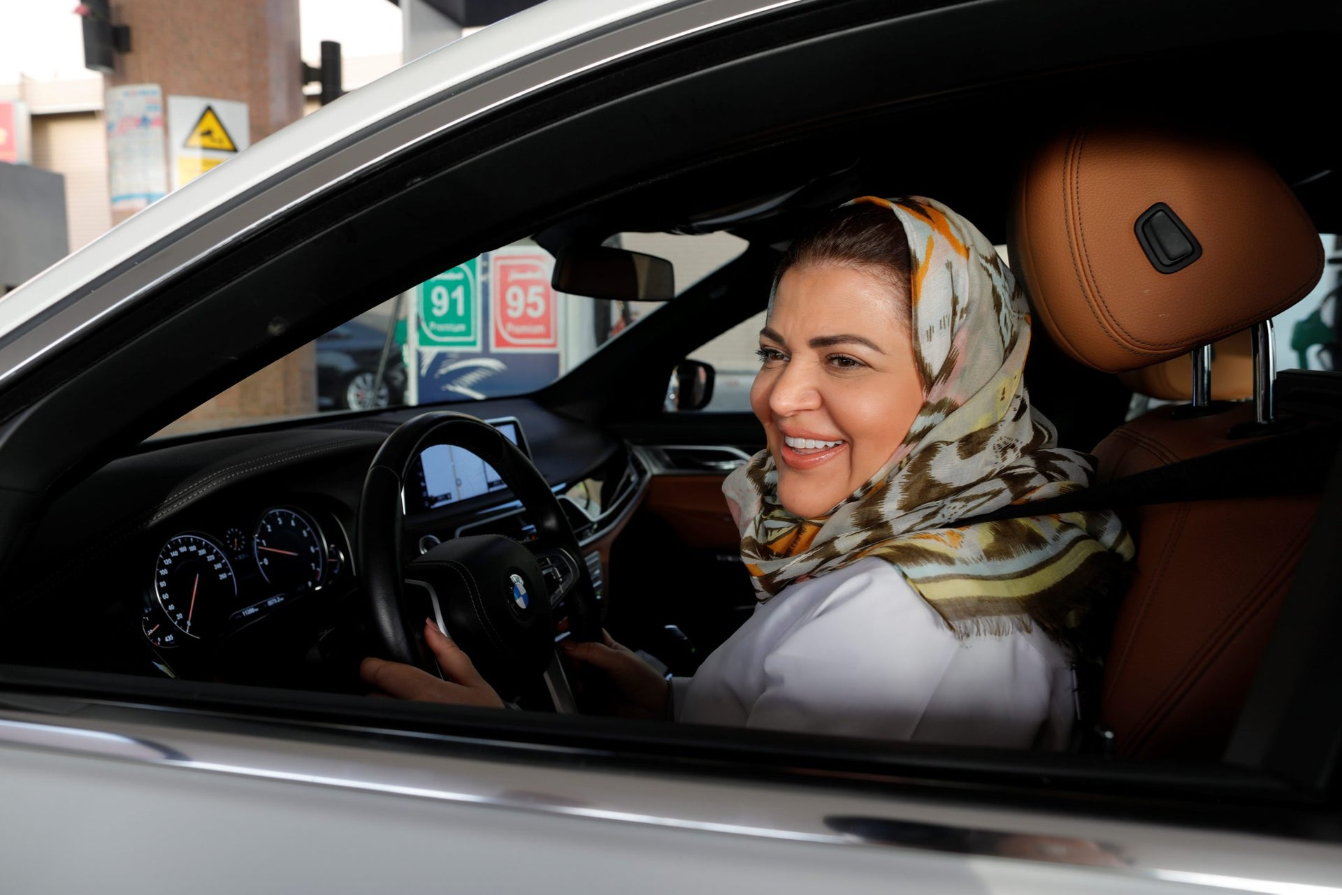 Dr Samira al-Ghamdi, a practicing psychologist, drives her car out in her neighborhood while going to work, in Jeddah, Saudi Arabia June 24, 2018.