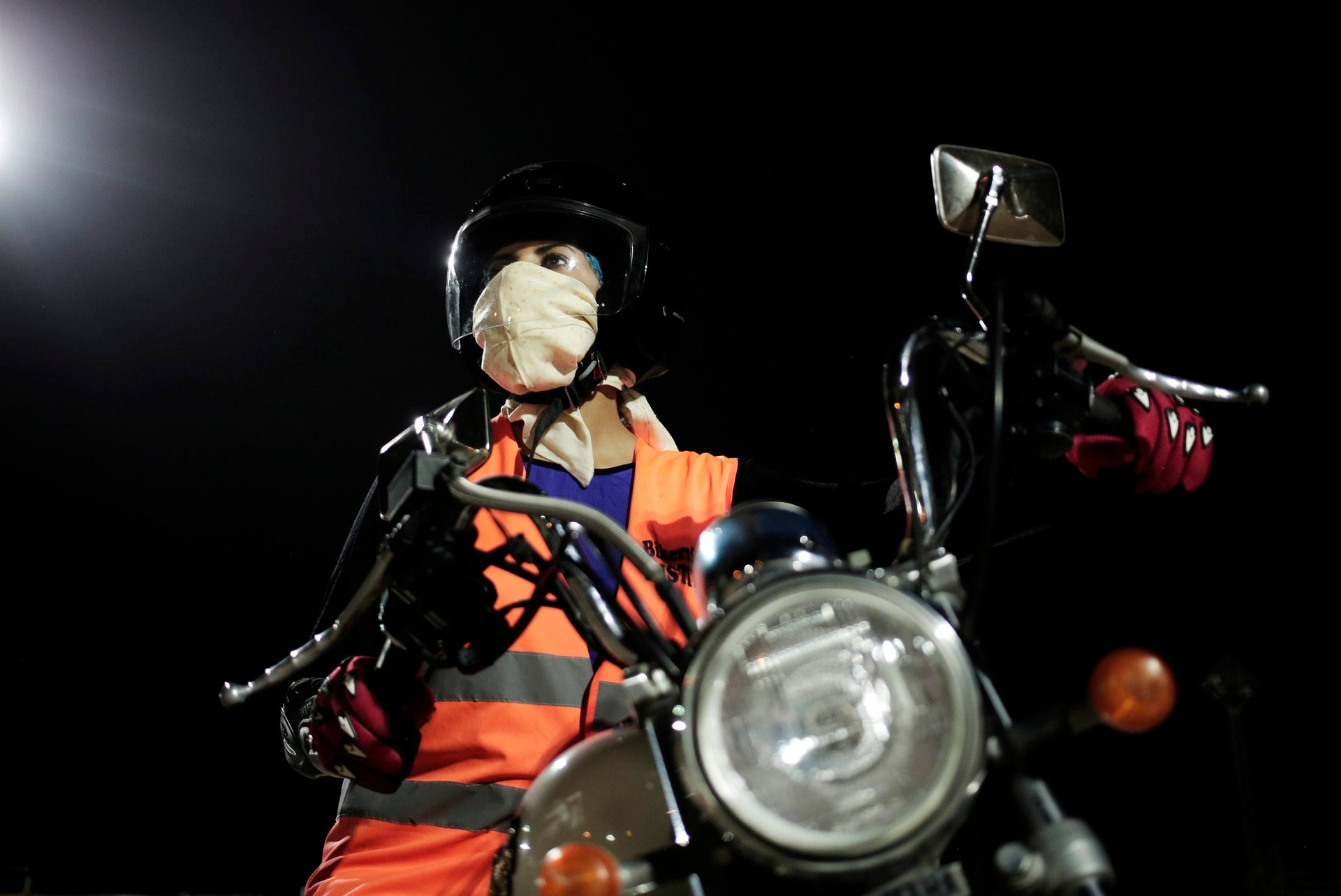 In this June 23, 2018 photo, Maha Mohammed poses for a photograph on a motorbike as she learns how to ride, at the Bikers Skills institute in Riyadh, Saudi Arabia. As Saudi Arabia prepares to lift a ban on women driving, Saudi women are being pushed to the forefront of a major transformation being spearheaded by the country's Crown Prince Mohammed bin Salman. It also places women in the crosshairs of a decades-old pull-and-tug between Saudis agitating for more social openings and a majority that remains deeply conservative.