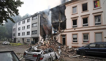 A car and a house are destroyed after an explosion in Wuppertal, Germany, June 24, 2018.