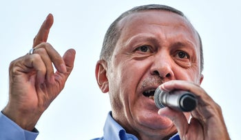 President of Turkey and the leader of the Justice and Development Party (AK Party) Recep Tayyip Erdogan speaks during a rally at the Gaziosmanpasa district of Istanbul, on June 22, 2018