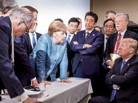 Leaders at the G7 summit in La Balbaie, Quebec stand near Donald Trump, June 9, 2018.