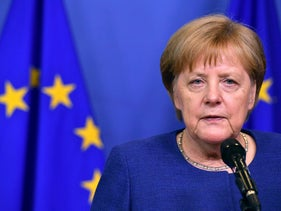 German Chancellor Angela Merkel speakings with the media at the conclusion of an informal EU summit on migration at EU headquarters in Brussels, Sunday, June 24.