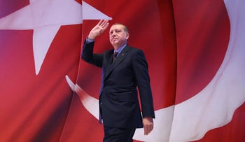 President Recep Tayyip Erdogan addresses his supporters during a referendum meeting in Istanbul.