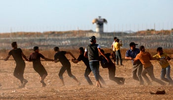 Palestinians trying to damage the border fence with Israel on Friday.