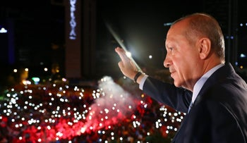 Turkish President Tayyip Erdogan greets his supporters from the balcony of his ruling AK Party headquarters in Ankara, Turkey, early June 25, 2018.