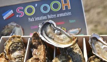 """This picture taken on October 30, 2017, shows a box of """"So'ooh"""" flavoured oysters in Marennes, southwestern France"""