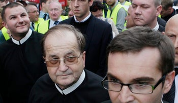 Priest Tadeusz Rydzyk, center, demonstrates against the government policies and to demand social welfare and job security, Warsaw, Poland, September 29, 2012.