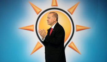 Turkish President Tayyip Erdogan announces his ruling AK Party's manifesto for next month's election in Ankara, Turkey, May 24, 2018.