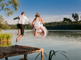 Bride and groom jumping in the lake, 2014.