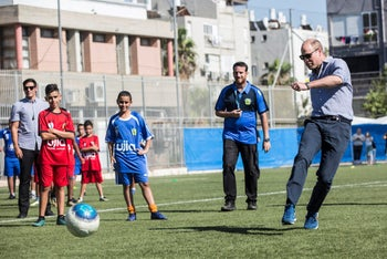 Britain's Prince William participates in a soccer game with Jewish, Muslim and Christian children organized by The Equalizer and Peres Center for Peace in Jaffa, June 26, 2018.