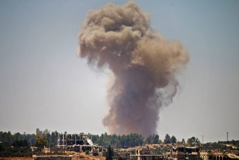 A regime air strike in the Syrian region of Dera'a on Tuesday, June 26, 2018