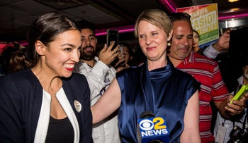 Progressive challenger Alexandria Ocasio-Cortez is joined by New York gubenatorial candidate Cynthia Nixon at her victory party in the Bronx, June 26, 2018.