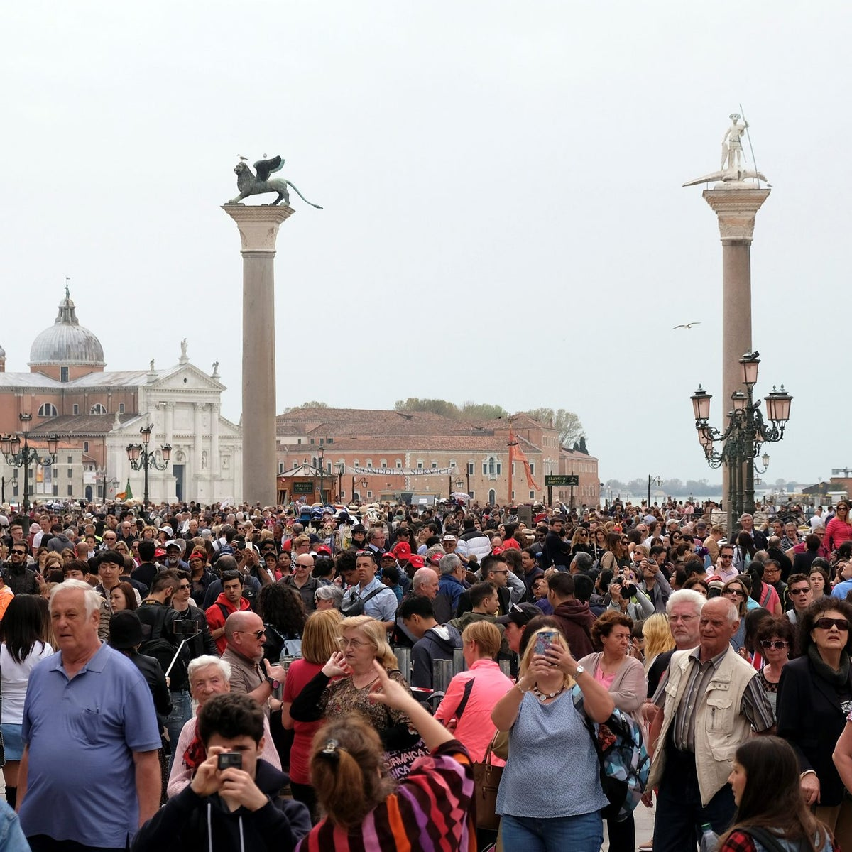 Tourists are seen at St. Mark's square in Venice, Italy, April 15, 2108.
